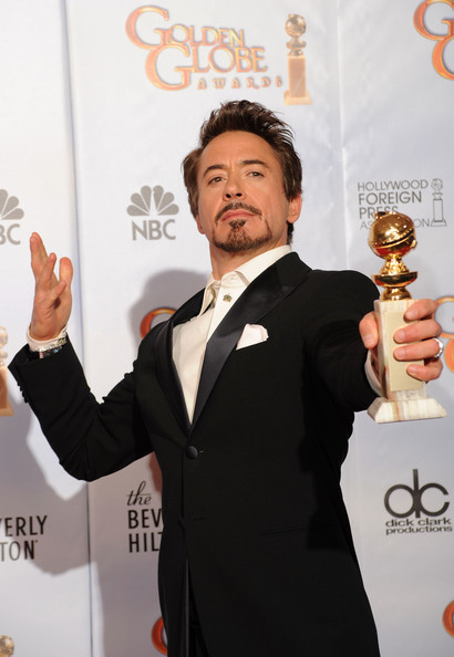 Robert Downey Jr., winner of the Best Actor in a Motion Picture Comedy or  Drama